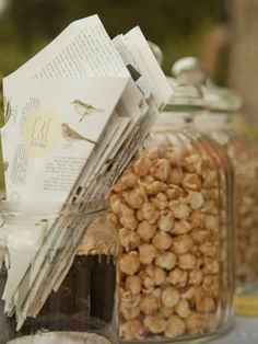 popcorn bar: these cones are made out of book pages, but white vellum would be elegant