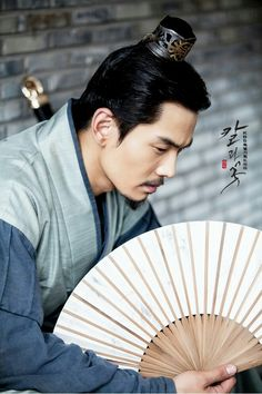 """The Blade and Petal (Hangul: 칼과 꽃; RR: Kalgwa kkot; lit. """"Sword and Flower"""") is a 2013 South Korean television series that aired on KBS2. Kim Ok-binand Uhm Tae-woong play star-crossed lovers doomed by their fathers' epic battle for political power during the Goguryeo dynasty.["""
