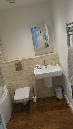 #White #bathroom with #sand coloured #porcelanosa tiles and #Twyfords bathroom suite. #karndean oak floor. May change the white walls one day,  but looks nice and fresh. #Whitby #Harbour Apartment Www.whitbyholidayhome.com