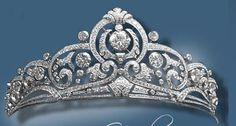 Belgian Scroll Tiara deisgned by Henry Coosemans in 1953. Set in platinum it holds 854 diamonds with 46.42 carats. The 8 carat center stone can be removed and worn as a ring, and the central element can be worn as a brooch. The Sociéte Générale, Belgium's national bank, gave it to the Grand Duchess  Princess Joséphine-Charlotte of Belgium as a wedding gift. (blue)