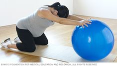 Pregnancy stretches — pregnant woman practicing backward stretch with fitness ball