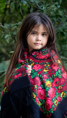This red Russian shawl is available in our Etsy shop. It is a beautiful shawl in red and black, shown on an Uzbek girl. Russian shawls were traditionally worn and treasured by women along the Great Silk Road.
