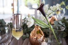 Riverside Country Estate was the perfect backdrop for our Modern Elegance Styled Wedding Shoot {as featured on Mooi Troues earlier this year}. We love combining simple elements like glass & copper with a very simplistic greenery runner, adding a few Black Calla Lilies & White Tulips for a pop of colour. Follow us on Facebook @Pronkertjie for more of our work Black Calla Lily, White Tulips, Calla Lilies, Country Estate, Wedding Shoot, Decoration, Greenery, Color Pop, Glass Vase