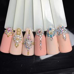 Opting for bright colours or intricate nail art isn't a must anymore. This year, nude nail designs are becoming a trend. Here are some nude nail designs. Swarovski Nails, Crystal Nails, Rhinestone Nails, Bling Nails, Swag Nails, Gem Nails, Diamond Nails, Nude Nails, Nails With Diamonds