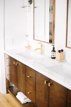 Custom mid-century modern wood bathroom vanity designed by Carly Waters Style