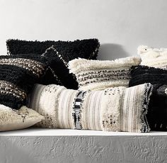 Pillows and Poufs, Restoration Hardware's Moroccan Wedding collection pillows, complete with neutral shades and metal embellishments