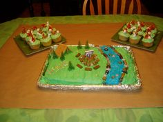 Camping Cake (with Graham Cracker Tent, Pretzel Bonfire, Tootsie Roll Logs, Jelly Bean Rocks) and Campfire Cupcakes