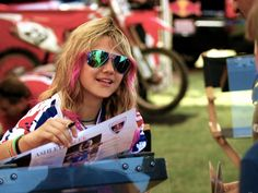 Ashley Fiolek - USA - 2008: A racing sensation, Ashley has blazed a trail for female motocrossers by claiming a factory American Honda Racing ride (the first female motocrosser to do so), earning three WMX titles ('08-'09, 2011) and snagging the 2009 and 2010 XG gold in Racing. What's more, Ashley is profoundly deaf and rides by feeling the vibrations in her bike, which tell her when to shift gears.  #womens #history #women #athletes