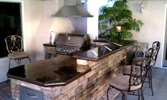 Outdoor kitchen with concrete counter top