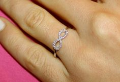 Hey, I found this really awesome Etsy listing at https://www.etsy.com/pt/listing/213908011/infinity-diamond-ring-18k-white-gold-and