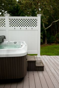 Hot tub on deck with outdoor shower.