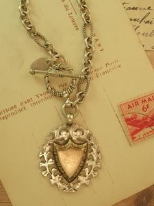 Antique English sterling and rose gold fob on a modern chain.  One of my faves!