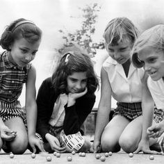 """LOVED """"ally's"""" (marbles) - except we'd make a nice, smoothly scooped out hole in which to shoot the marbles, to play the game . winner takes all, unless """"keepsies"""" was declared before starting the game. 1 Year Baby, Back In My Day, Creepy Stories, Black And White Pictures, The Good Old Days, Vintage Children, Looking Back, Kids Playing, Childhood Memories"""