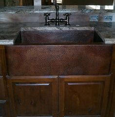 Jim G's hammered copper farmhouse sink, with wood cabinets and oil rubbed bronze faucet!