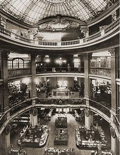 """Circa 1925 - The City of Paris Department Store - Southeast corner of Geary and Stockton, site of the current Neiman-Marcus Store. The restaurant was called """"Normandy Lane"""". This inner courtyard was saved and incorporated into the new building."""