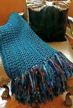 "I've crocheted 7 of these for Christmas gifts this year. Soft pretty throw or ""Lapghan"" I made from a very simple single crochet pattern I found here on Pinterest (see link). However, I made an 8"" fringe of various textures and yarns to make it a little more interesting. I used Lion Brand Homespun ""Lagoon"" yarn for the body which is so soft and easy to work with. #Christmas Crochet Patterns"