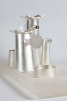"""""""Coffee & Tea too"""" by Rob Thalen & Jaap Thalen.  Coffee & Tea II, or coffee and tea too. A set for those who like it all... Developed in our search for shapes that are linked to architecture, that act like tall buildings in a city."""