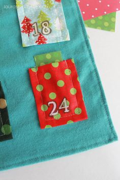 DIY fabric advent calendar. Pockets for you to slip in printable activities for each day leading up to Christmas.