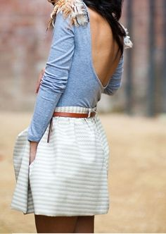 backless shirt and striped skirt