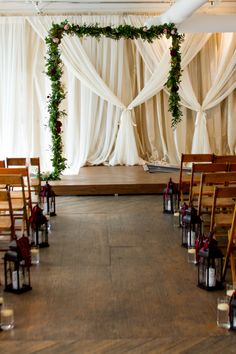 Simple Altar created with beautiful draping, and and A-semmetrical hung garland, accented with touches of floral.