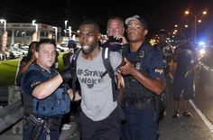 Black Lives Matter activist Deray McKesson arrested while Periscoping Police arrested more than 200 people marching down the side of the road in Baton Rouge Louisiana last night according to several reports including a strong voice in the Black Lives Matter movement Deray McKesson.  McKesson who is very active on social media and police reform projects was taken into custody Saturday night while walking down the side of the road and filming the protest on Periscope.  The protest was one of…