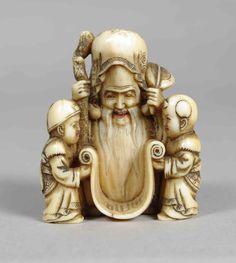 Antique carved ivory netsuke depicting Fukurukuju and two children
