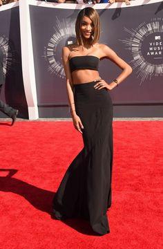 Model Jordan Dunn stuns in a black dress and black strapless crop top as she strike a pose at the 2014 MTV VMAs.
