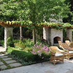 Stone fireplace and columns with attached arbor