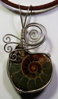Ammonite fossil wire wrapped pendant in alpaca by ivysgembox