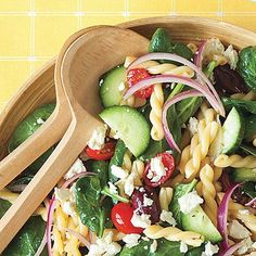Greek Pasta Salad | Go Greek with your pasta salad by stirring in cucumber, tomato, olives, spinach, and feta, and tossing in a tangy vinaigrette.