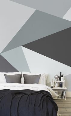 Snooze away under stylish monochrome geometrics. This wallpaper design combines elegant shades of grey with a sharp defined lines. It's perfect for modern bedroom spaces looking for statement walls that ooze style.