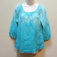 Eyelet cotton top Beautiful blue, flowy top.  Flower design.  So cute for Spring!  100% cotton. Tops Tunics