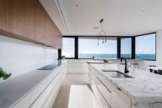 White coastal kitchen complements t. - Gallery - 4 White coastal kitchen complements t. White Coastal Kitchen, White Beach Houses, Stone Flooring, Modern Kitchen Design, Kitchen Interior, Gallery, Room, Invite, Kitchens