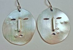 fused silver with cut outs