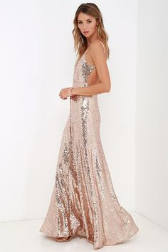 Ignite the night and charm all you encounter in the Charismatic Spark Gold Sequin Maxi Dress! A triangle bodice is packed with elegant appeal thanks to thousands of shimmering sequins, while spaghetti straps frame a sultry open back. A dreamy maxi-length skirt flows gracefully from a fitted waistline to a floor-length hem. Hidden back zipper/hook clasp.