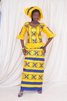 An exciting mixture of two colors is what makes up this yellow coloured brocade and blue broderie with medium length sleeves and gathered edges accompanied by wrapper and head wrap