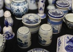 """Delft china incl decanter, shakers, vases, cups, decorative pcs, etc, largest being 9.5""""T"""