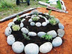 Spiral Herb Garden http://recycledawblog.blogspot.com/2013/04/herb-garden-in-rock-spiral.html