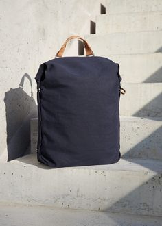 """A large, expandable main body contains multiple inner compartments, including a Merino felt-lined sleeve which fits up to 16"""" MacBook Pro®. A YKK® metal zipper with a unique cotton tape instead of the usual plastic one allows direct access to the main compartment via side entry, and the layout of small interior pockets is arranged to give frequently-used items a practical spot. Adjustable backpack straps and a modular handle provide versatile carrying options. - picture by Matthias Graf© Backpack Straps, Vegetable Tanned Leather, Macbook Pro, New Product, Biodegradable Products, Layout, Backpacks, Pure Products, Navy"""