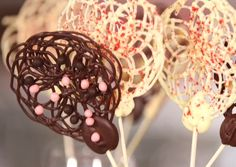How to Make Lovely Chocolate-Lace Lollipops - A great idea for a sweet treat that's fairly healthy. (You get the fun without the calories because even though the lollipops look big, they're mostly air. Clever!) http://www.kitchendaily.com/read/how-make-lovely-chocolate-lace-lollipops