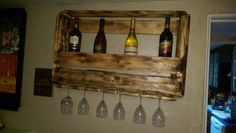 Used one thin long pallet, make sure you measure the bottles. And glasses position. And how many. You would like. I use a torch for the finish with sealer.     #PalletWineRack, #RecyclingWoodPallets