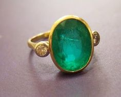 (WANT!) 18ct gold, emerald and diamond ring Est £500-700