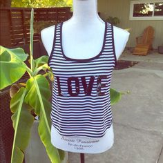"""Sequined """"LOVE"""" tank top Wore this lovely black and white striped midriff tank top once by Express.  All sequins are intact, no tears or stains. Express Tops Tank Tops"""