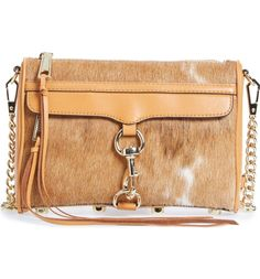 Lavish calf hair provides an instant Western update for the fan-favorite Mini MAC bag from Rebecca Minkoff.
