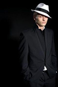 Man in Fedora and retro suit.