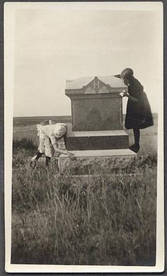 1920s vintage photo children play in cemetery graveyard gravestone vintage photo by Christian Montone, via Flickr