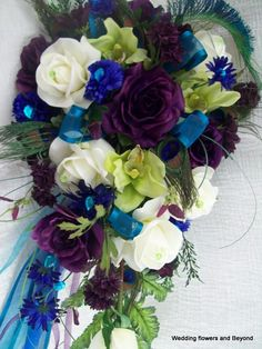 20 PieCe MaDe To oRDeR Royal Peacock Wedding Flower Package FeaTHeRS,TuLLe,RiBBoNS THiS oNe HaS iT aLL, Purple,Aqua, and Blue. $575.00, via Etsy.
