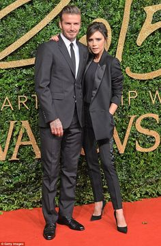 Victoria Beckham and husband David wear co-ordinated suits at British Fashion Awards...  The pair sported his-and-her outfits when they attended the event at the London Coliseum in Covent Garden.