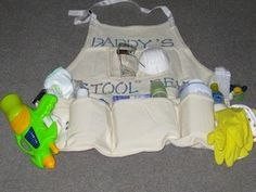 Daddy Stool Belt: .....Part 3 of Corina's Fabulous Baby Shower  Games: As people came in each received a bottle with a frozen baby and a necklace with a soother on the end.