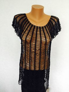 A personal favourite from my Etsy shop https://www.etsy.com/listing/239114537/black-beaded-tank-top-coverup-crocheted